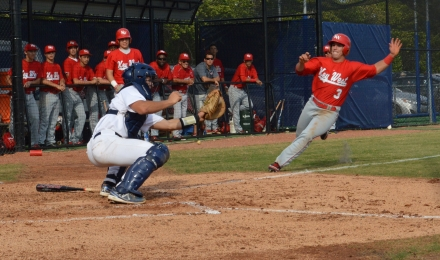 Gulliver Prep catcher Brent Diaz gets ready to tag out Key West's Darren Miller on Feb. 26.