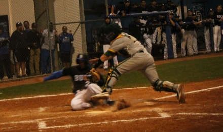Spencer Levine applies the tag on the runner on a big play at the plate in the bottom of the fifth.