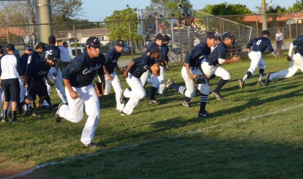 The Columbus Explorers take the field for warm-ups prior to their 9-2 win against Coral Park in a 8A-District 15 semifinal on April 23.