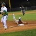 Mater Lakes' Marcus Villalobos safely dives into third base in the Bears' 3-1 win against LaSalle on Wednesday night at Barry University.